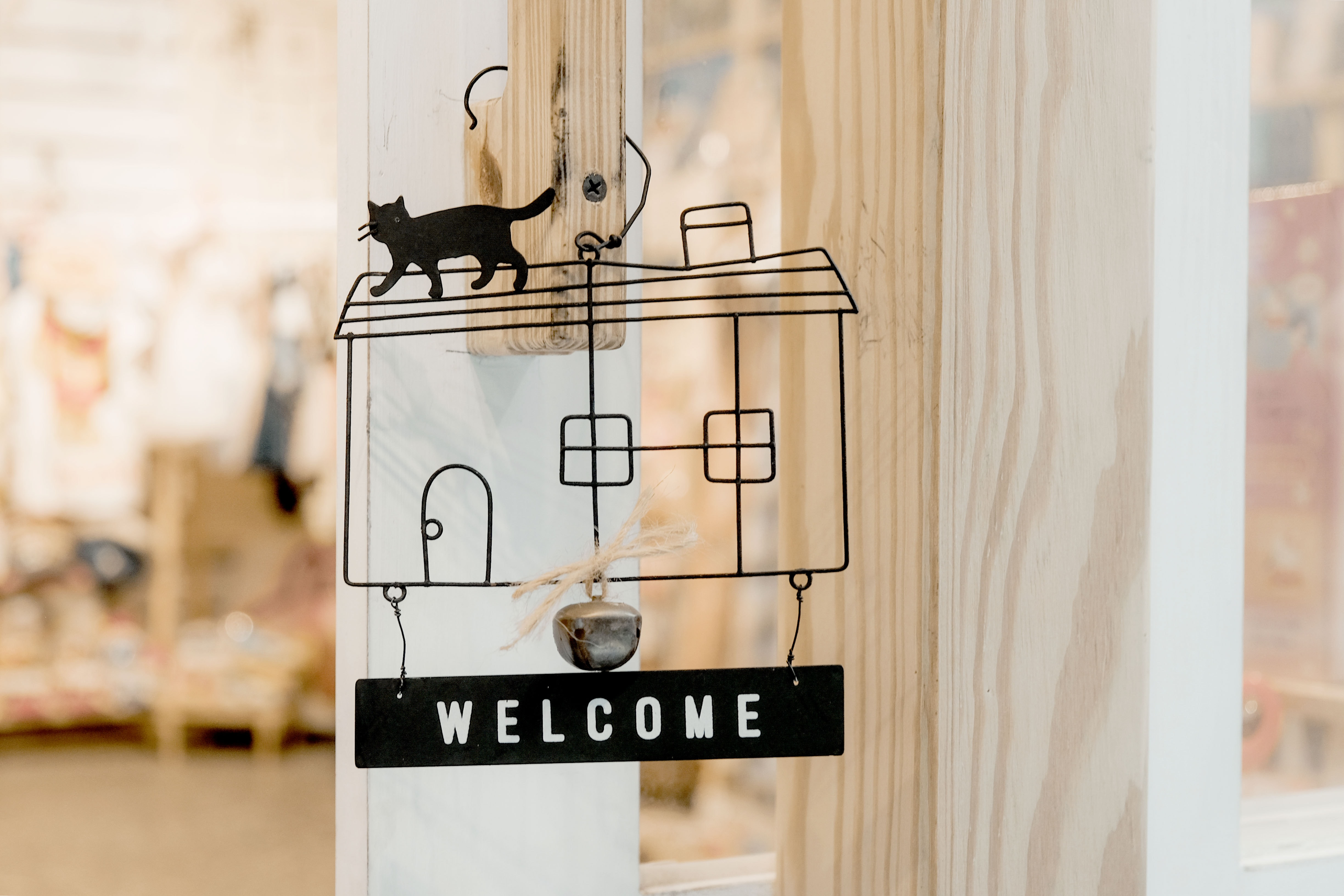 Welcome store sign photo