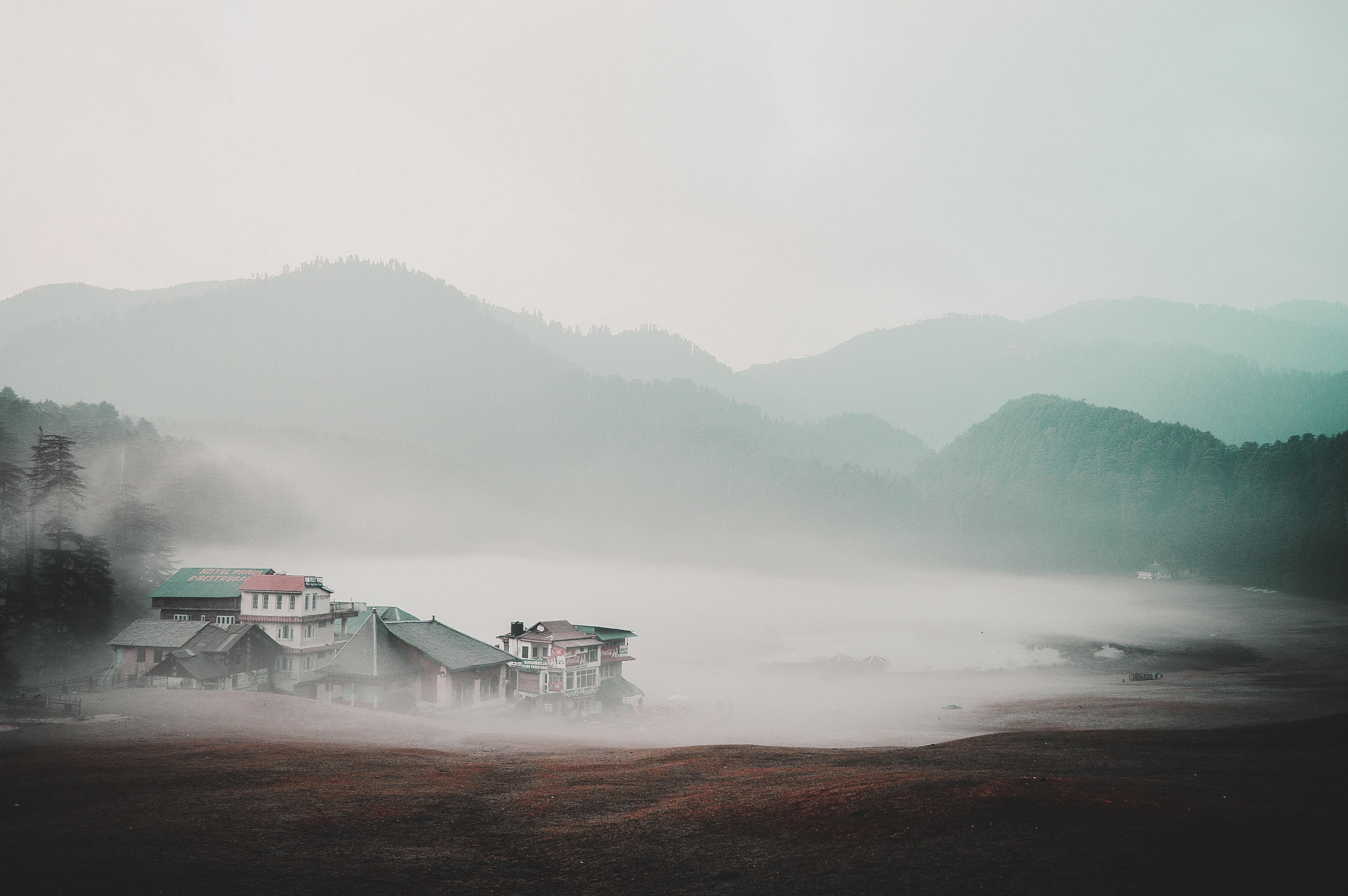houses near mountains at daytime