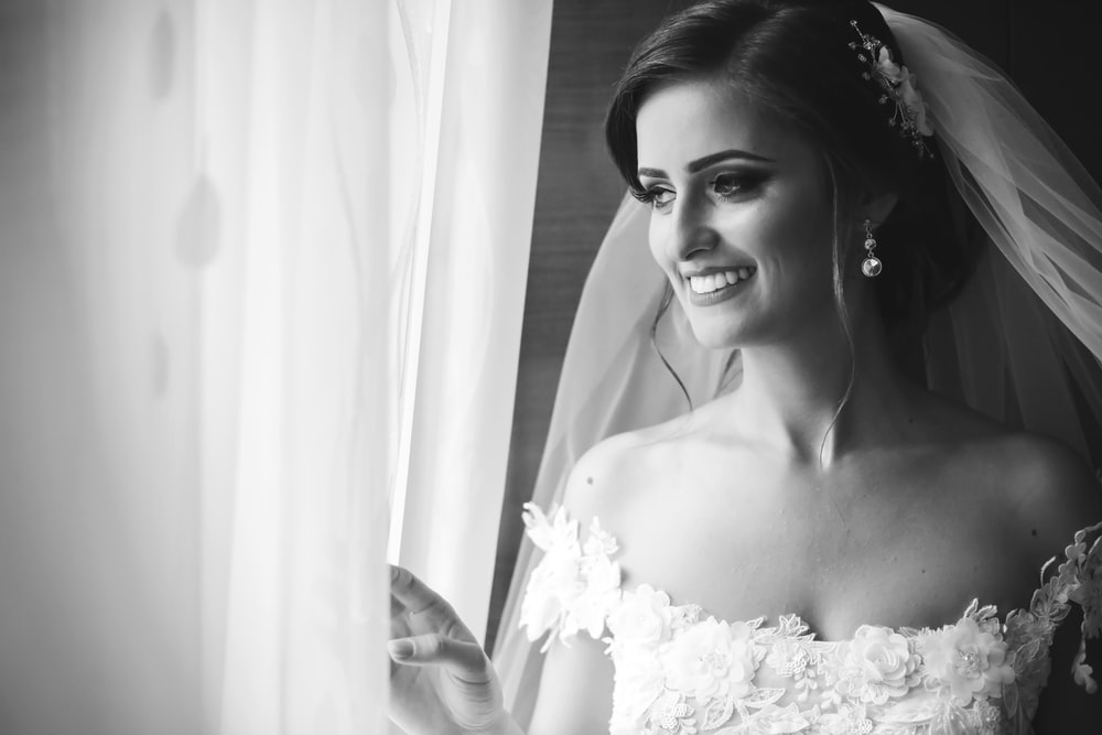 grayscale photo of woman in wedding gown