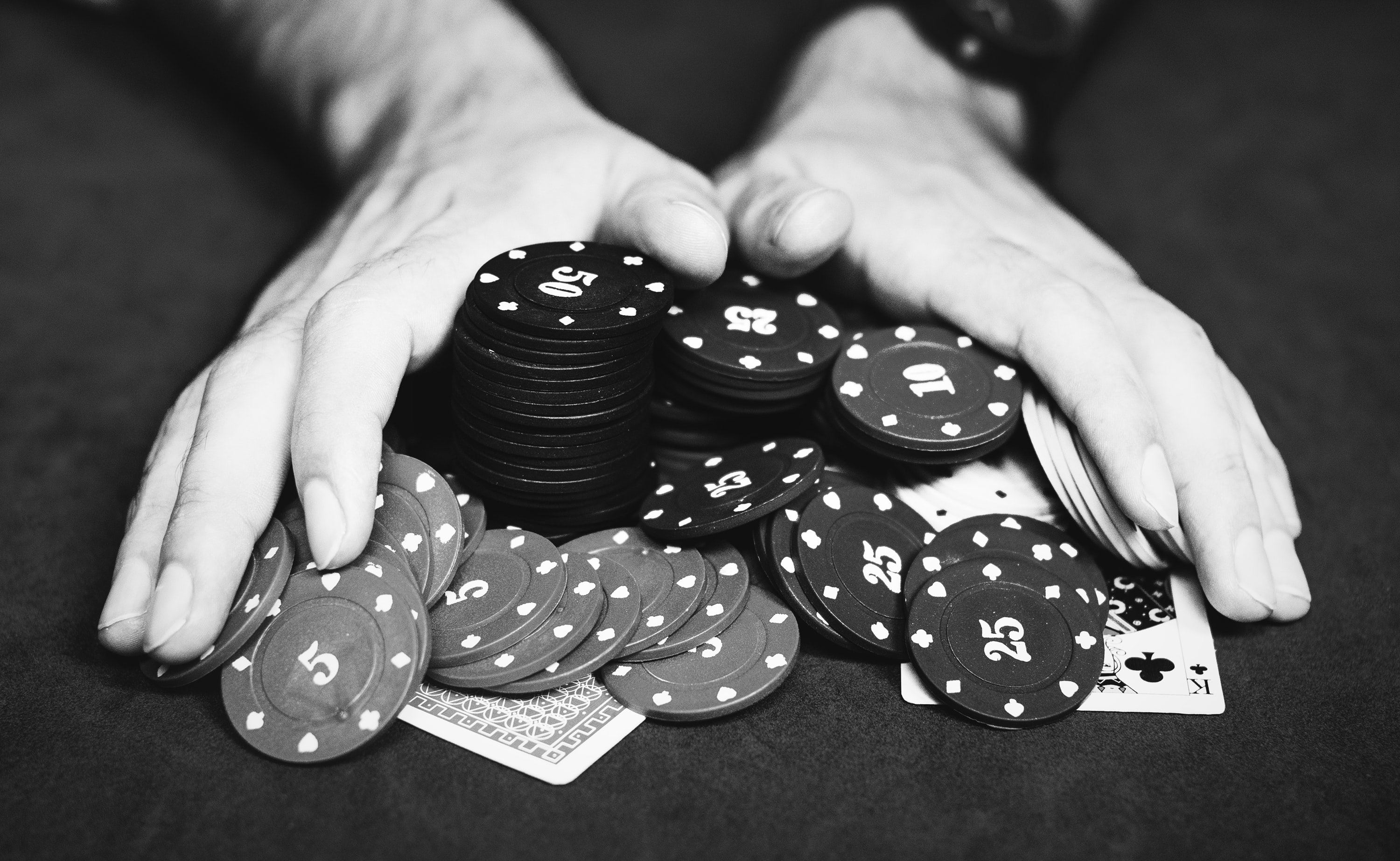 person holding poker chips