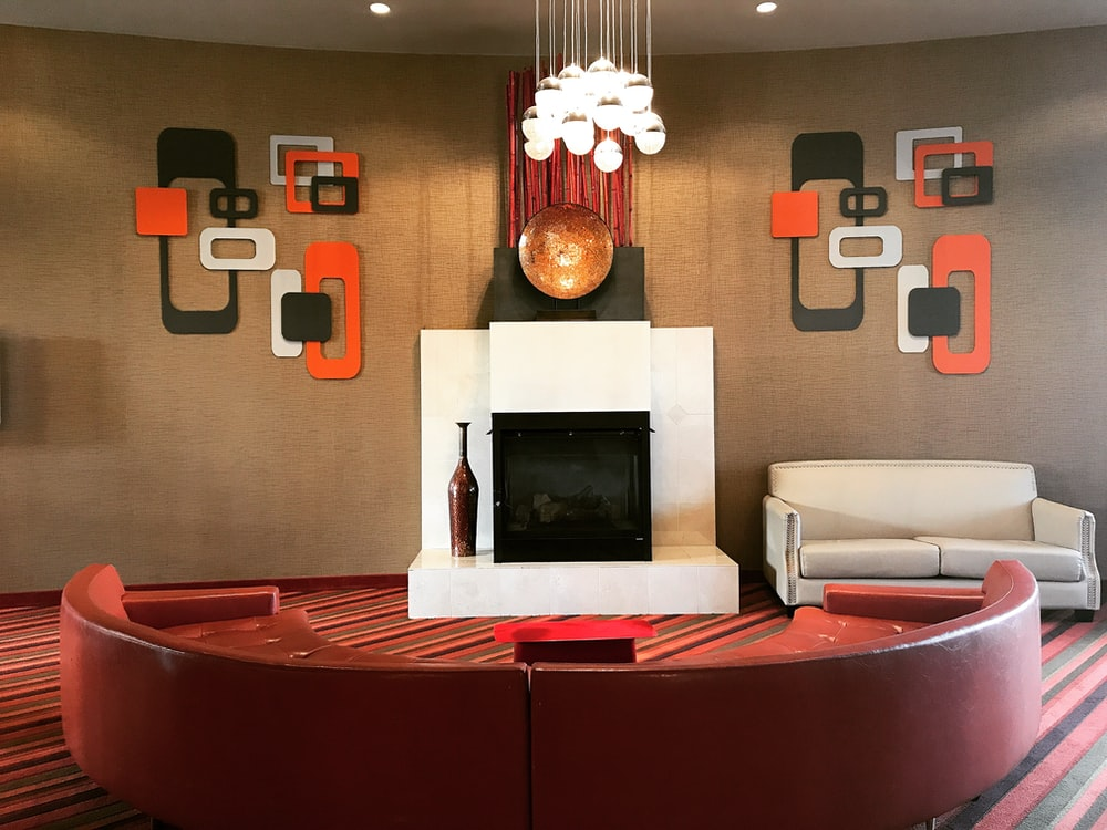red leather sofa with fire place