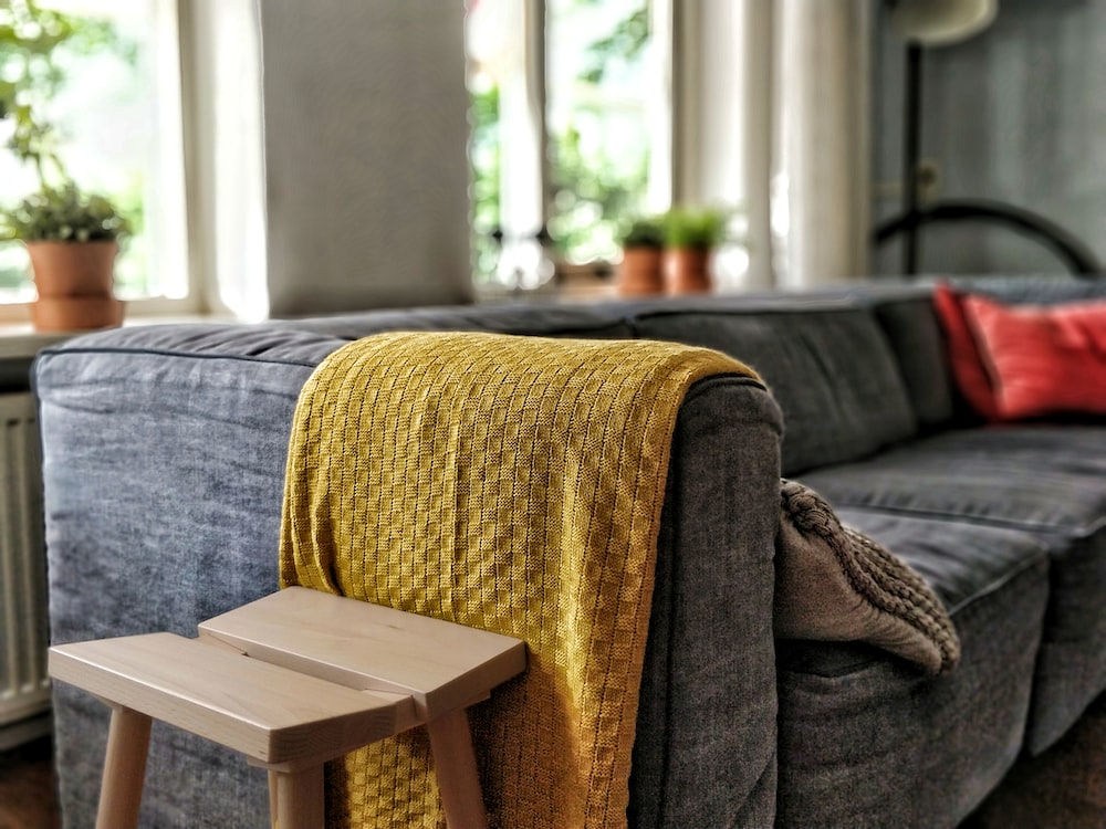 yellow textile on couch