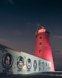 red lighthouse during nighttime