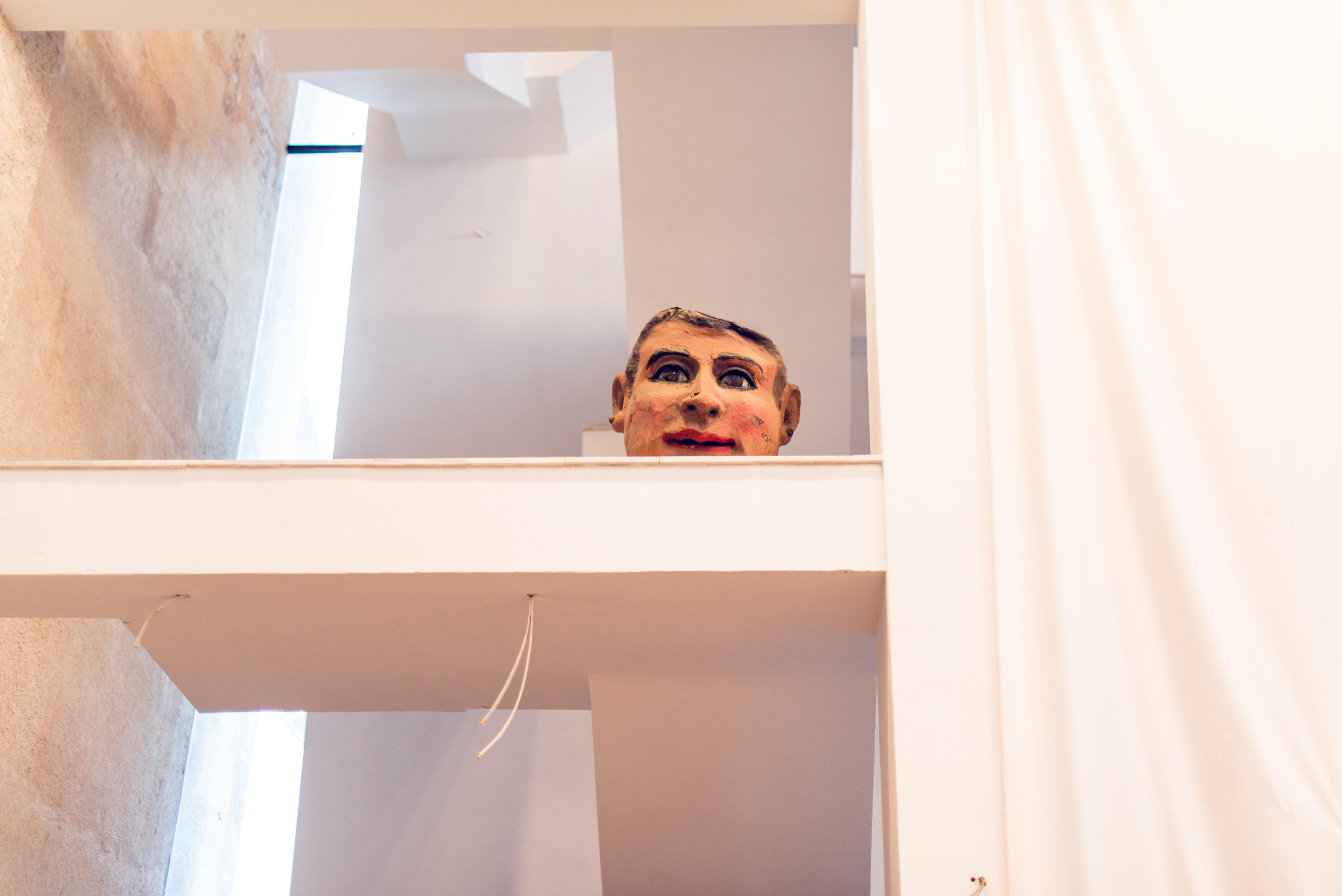 human face decor on shelf