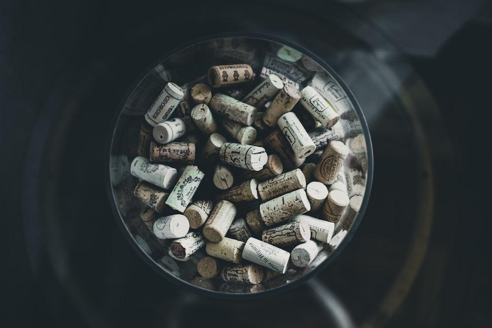 brown corks inside clear glass vase