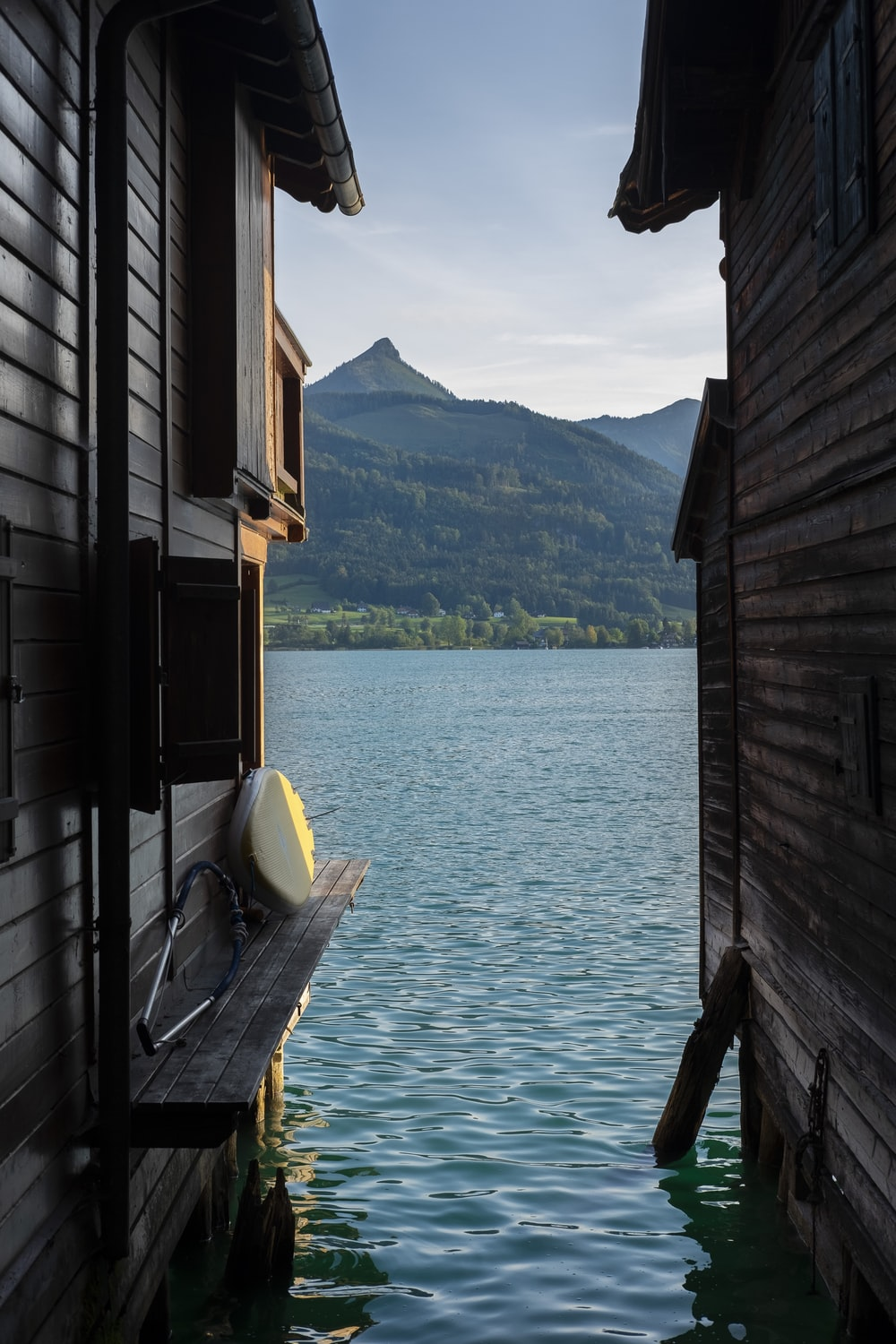 gray wooden house on body of water