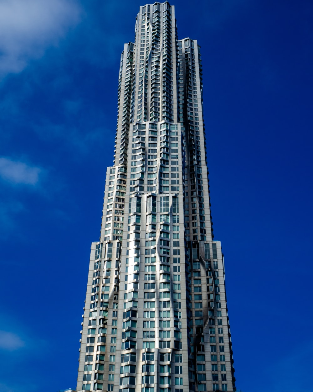 low angle photo of gray high rise building