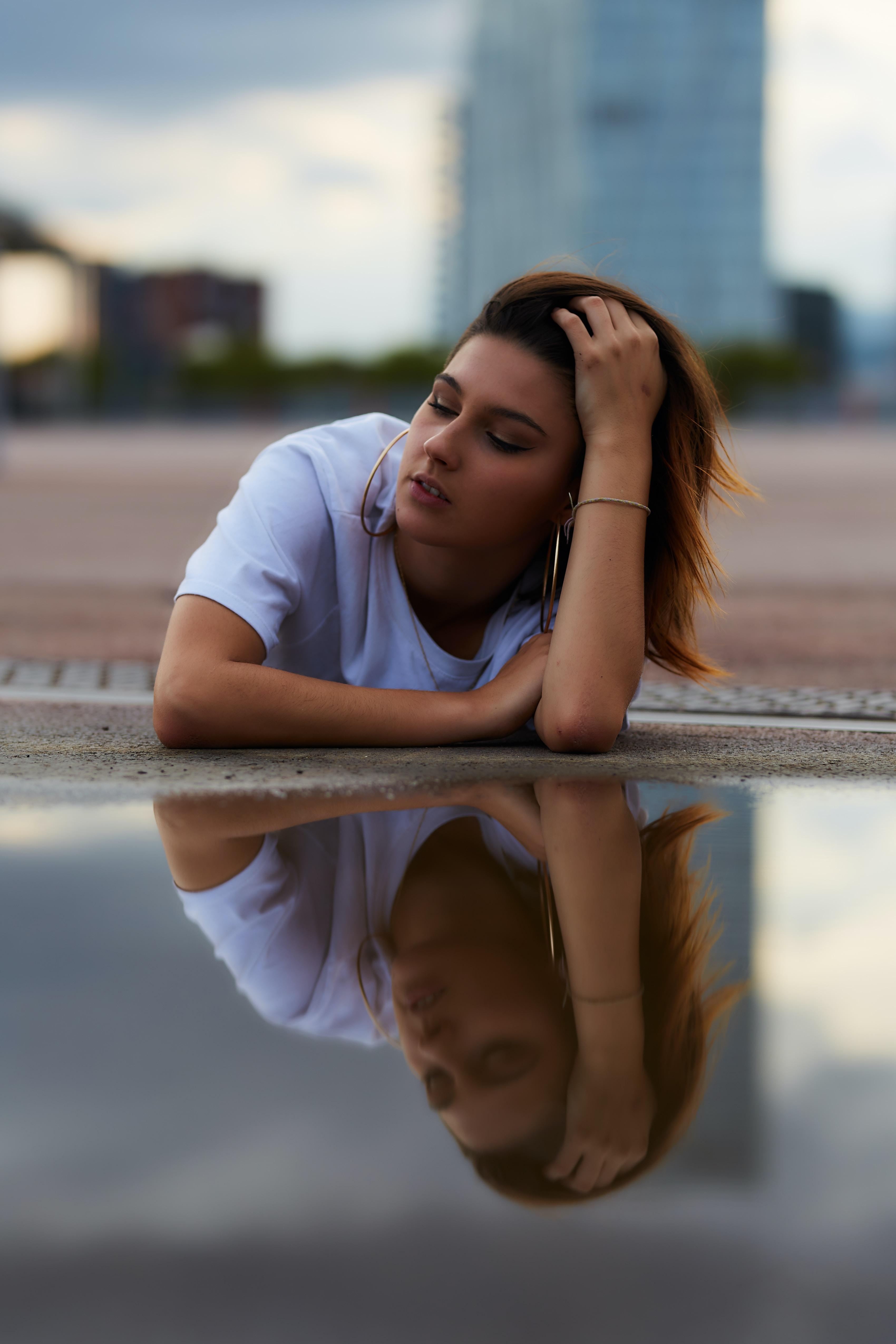 woman on concrete floor