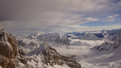 mountains under white clouds during daytime