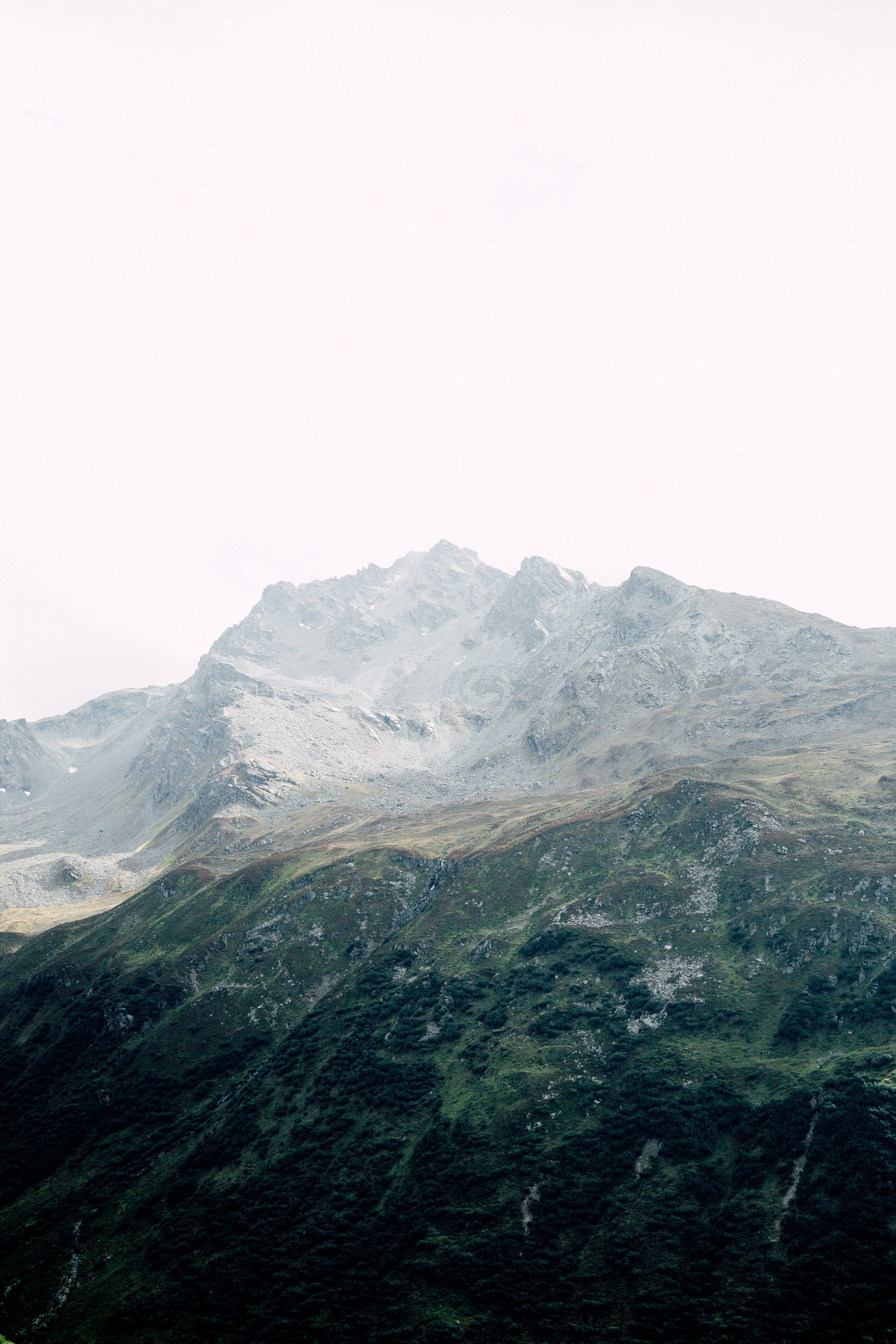 top view of mountain under white sky