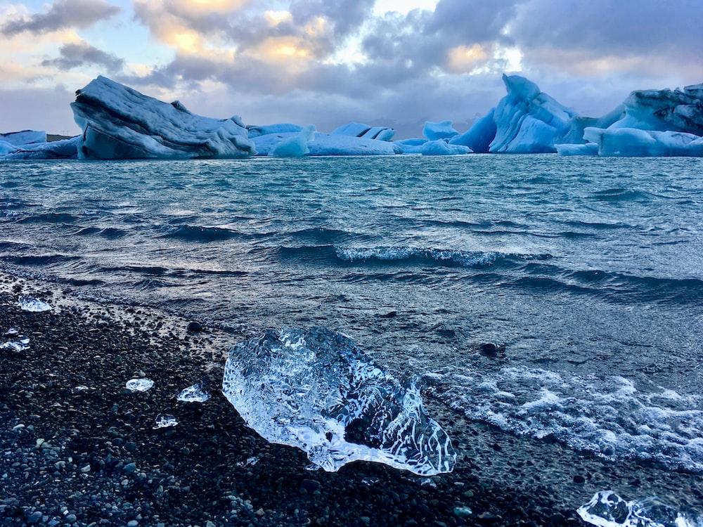 ice burg on body of water