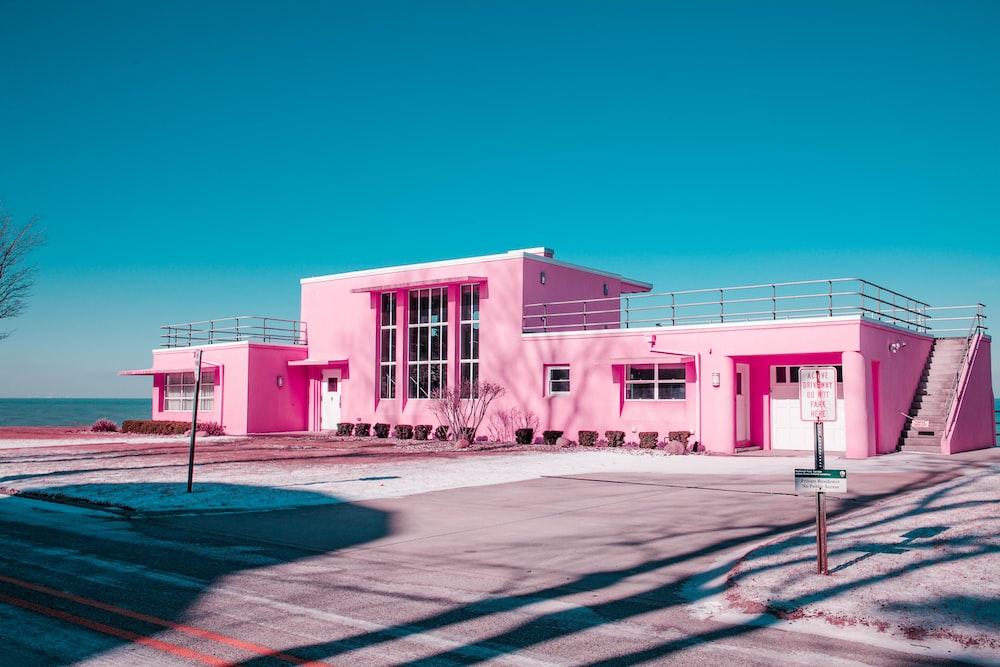 pink concrete building under clear blue sky