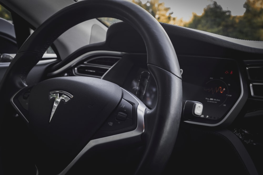 close-up photo of black vehicle steering wheel