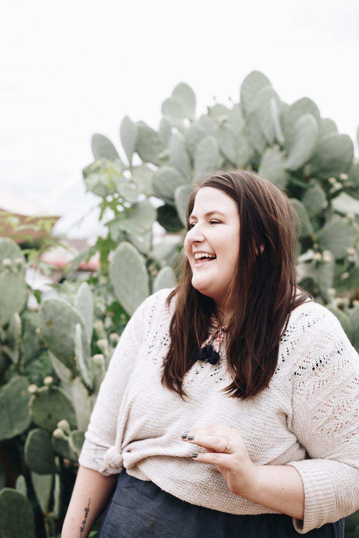 woman smiling wearing white lace shirt at daytime