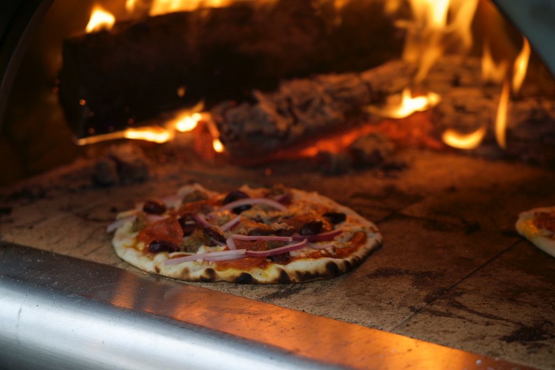 cooked pizza inside oven