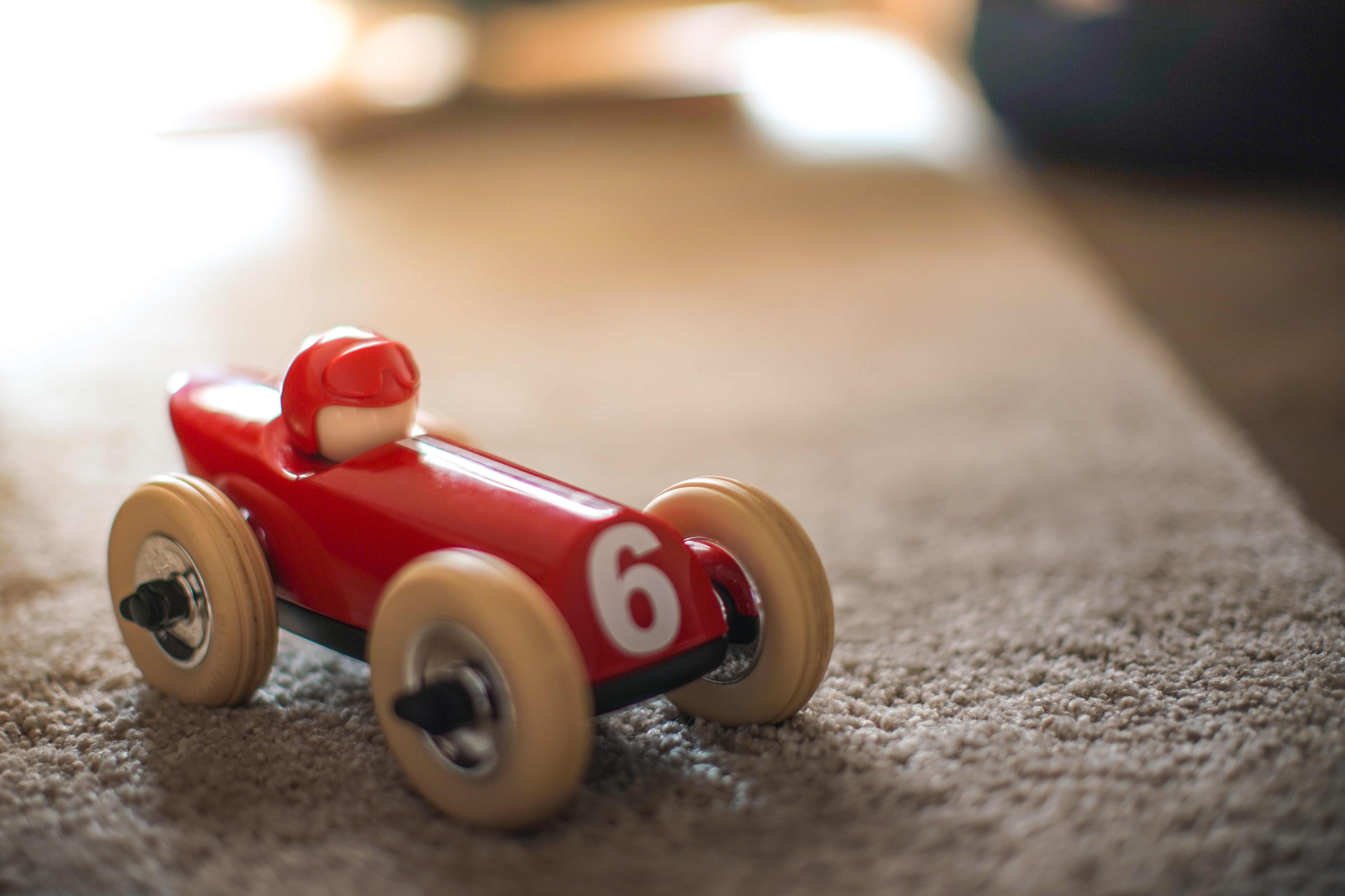 red and brown car toy
