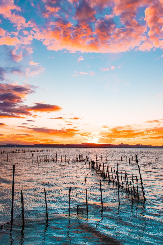 fish pen on ocean at golden hour