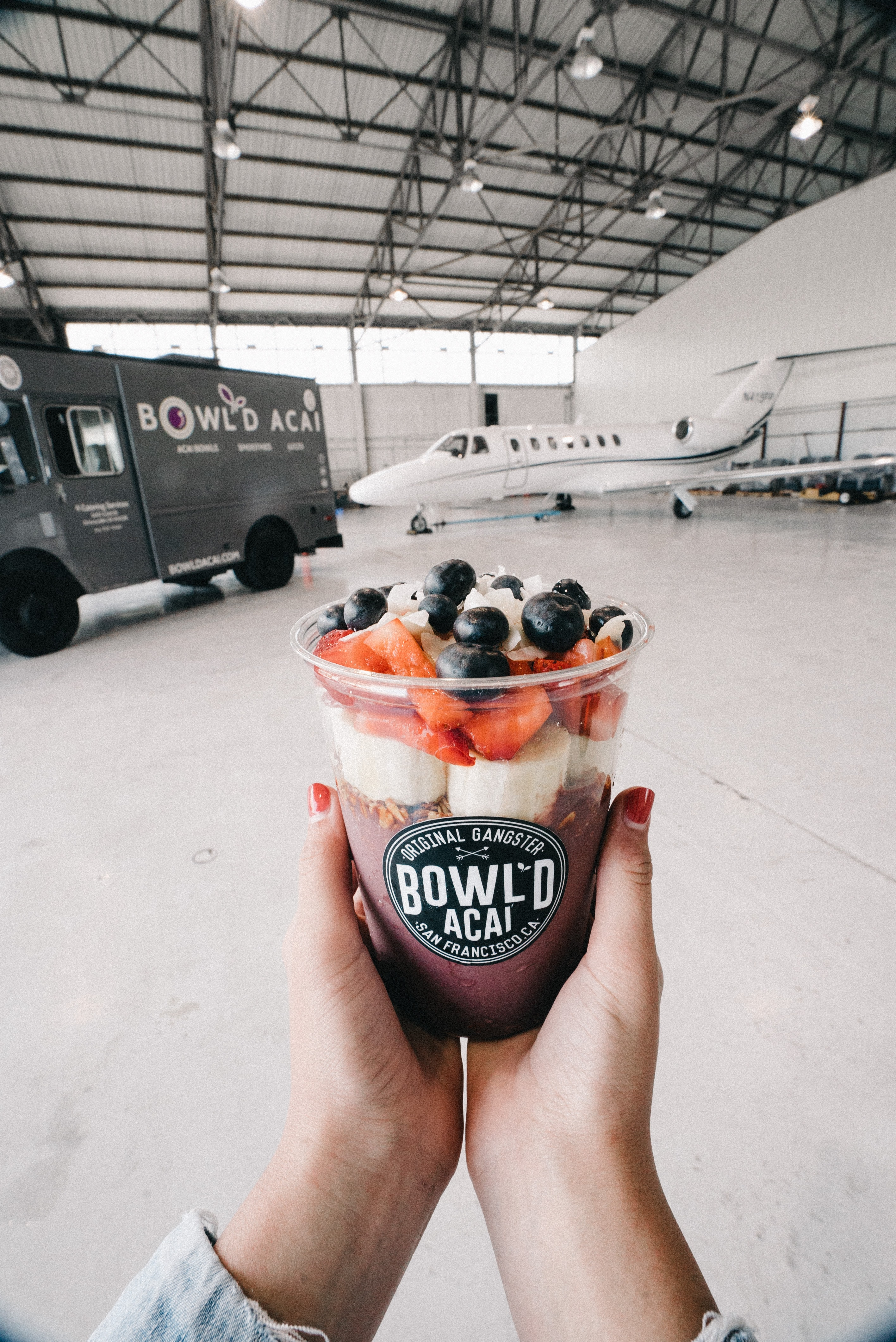 person holding Bowl'D acai cup