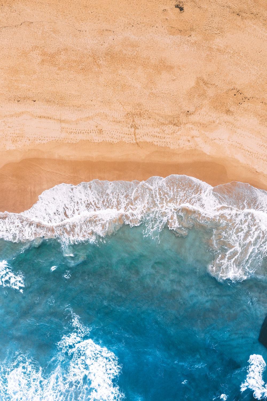 sea waves on brown sand