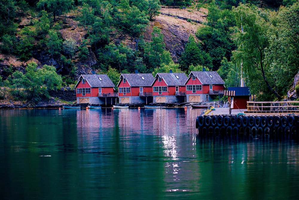 four red and grey house by the lake