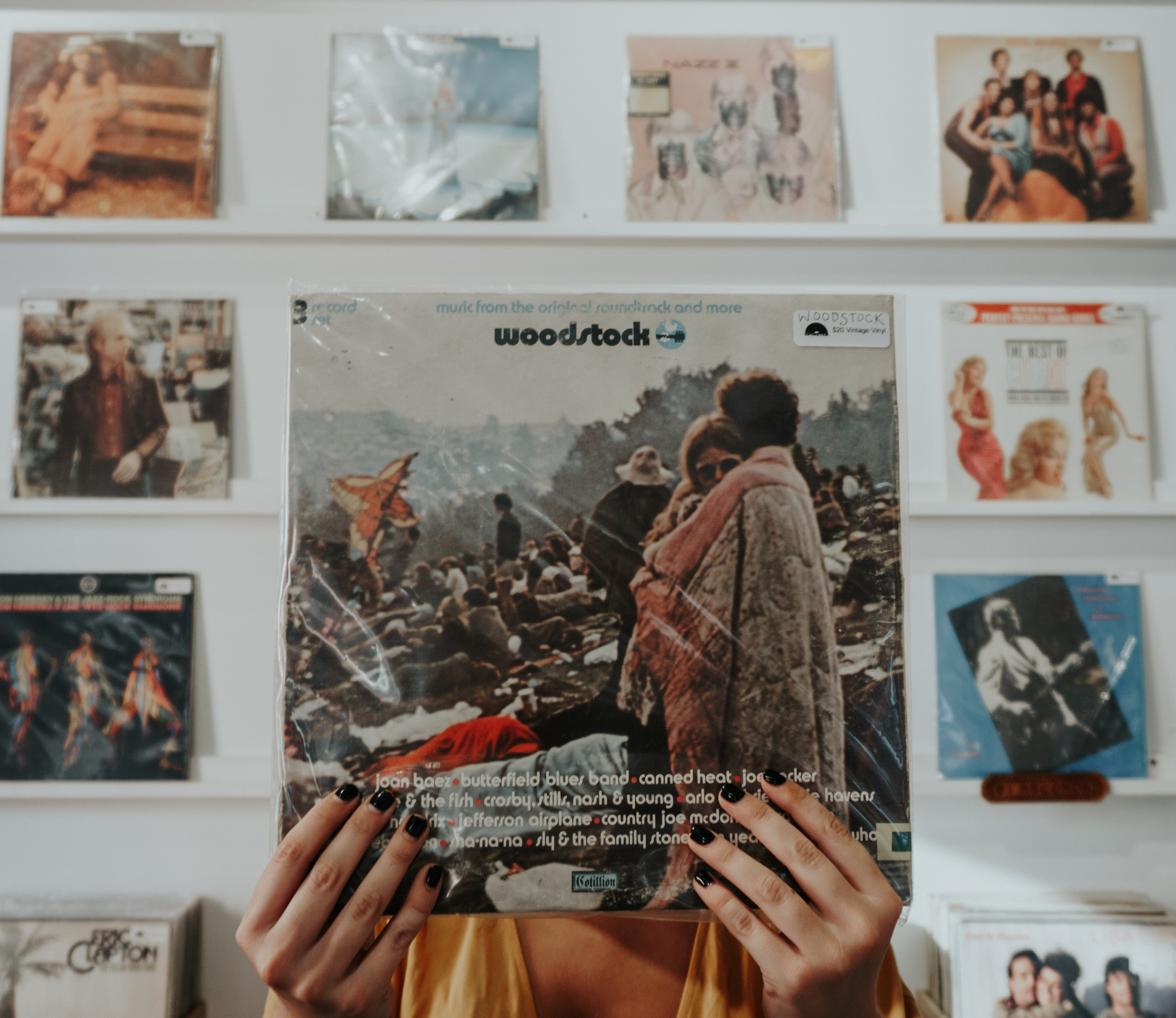 person holding Woodstock record sleeve pack