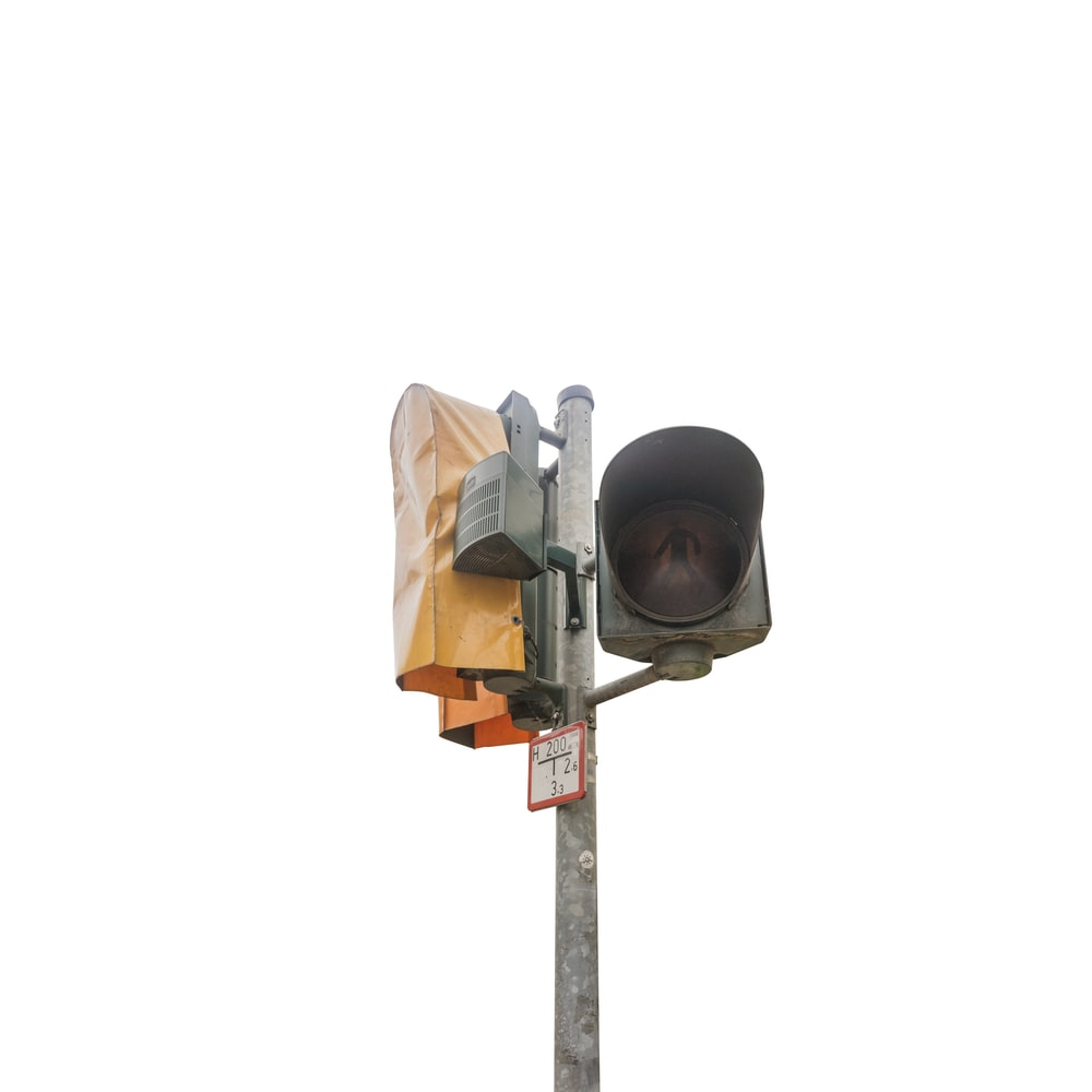 gray metal traffic light turned-off during daytime