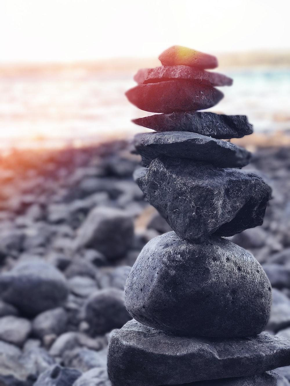 stack of stones near seashore at daytime