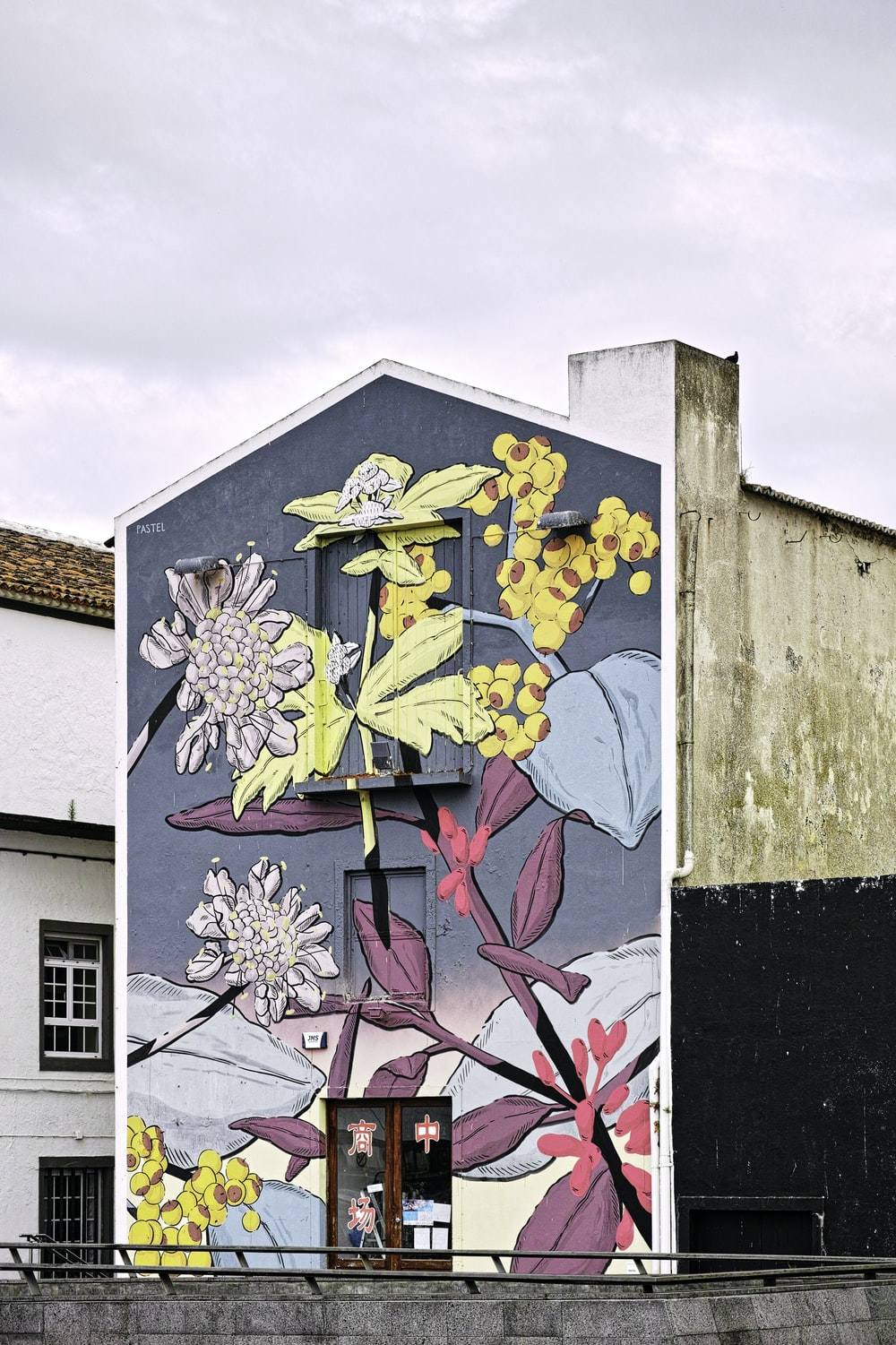 multicolored floral painting on building at daytime