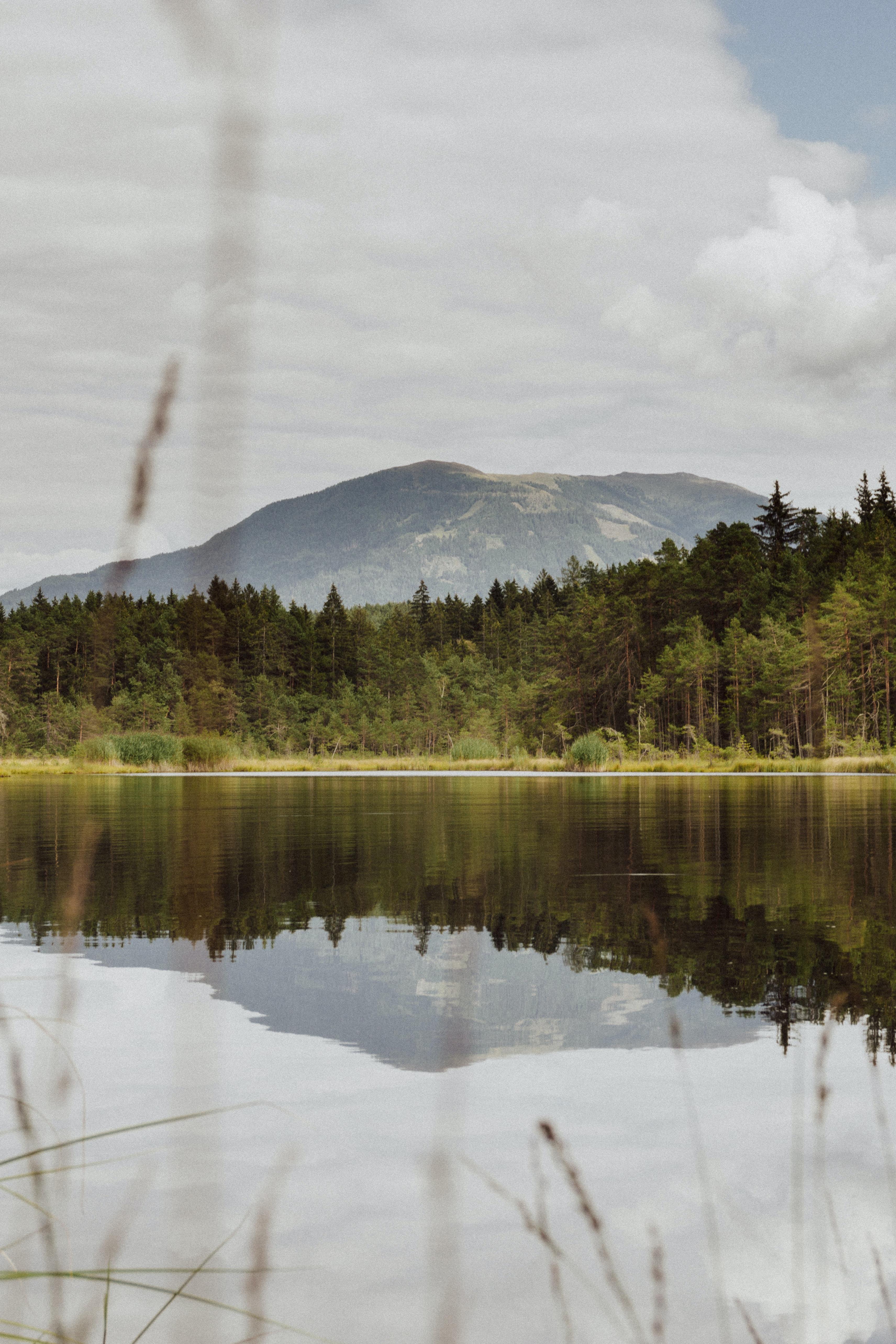 long exposure photography of lake near mountain