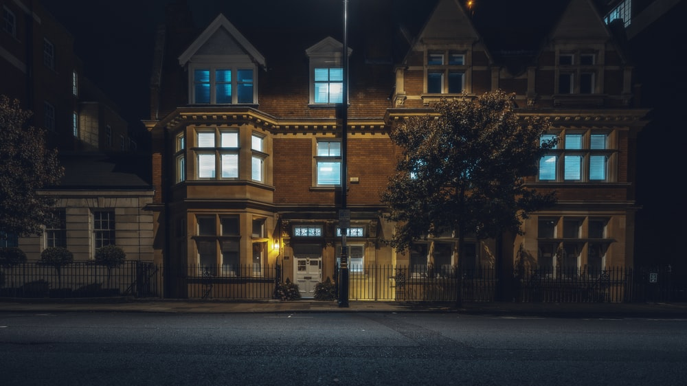 lighted house at night time
