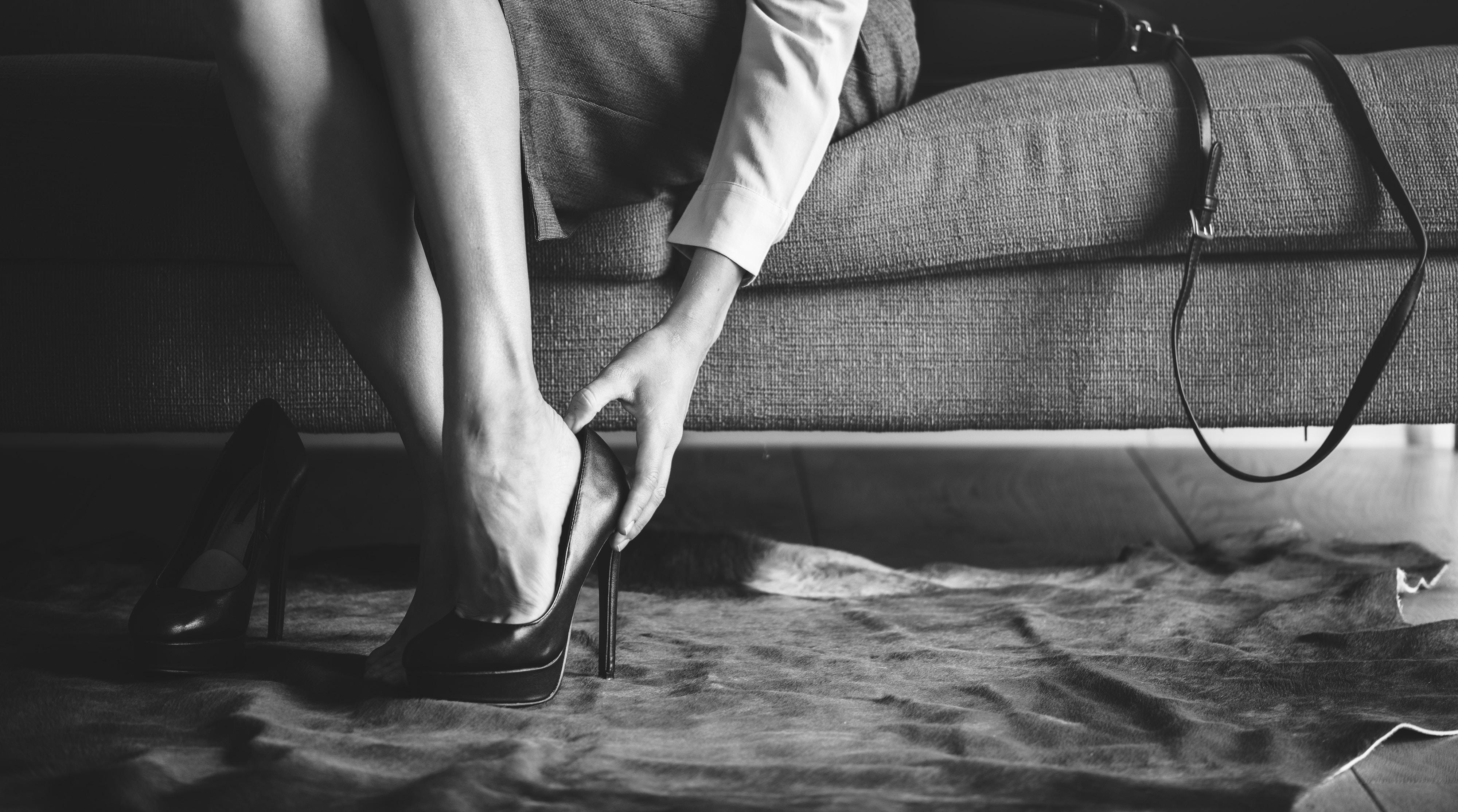 sitting woman wearing black stiletto pump