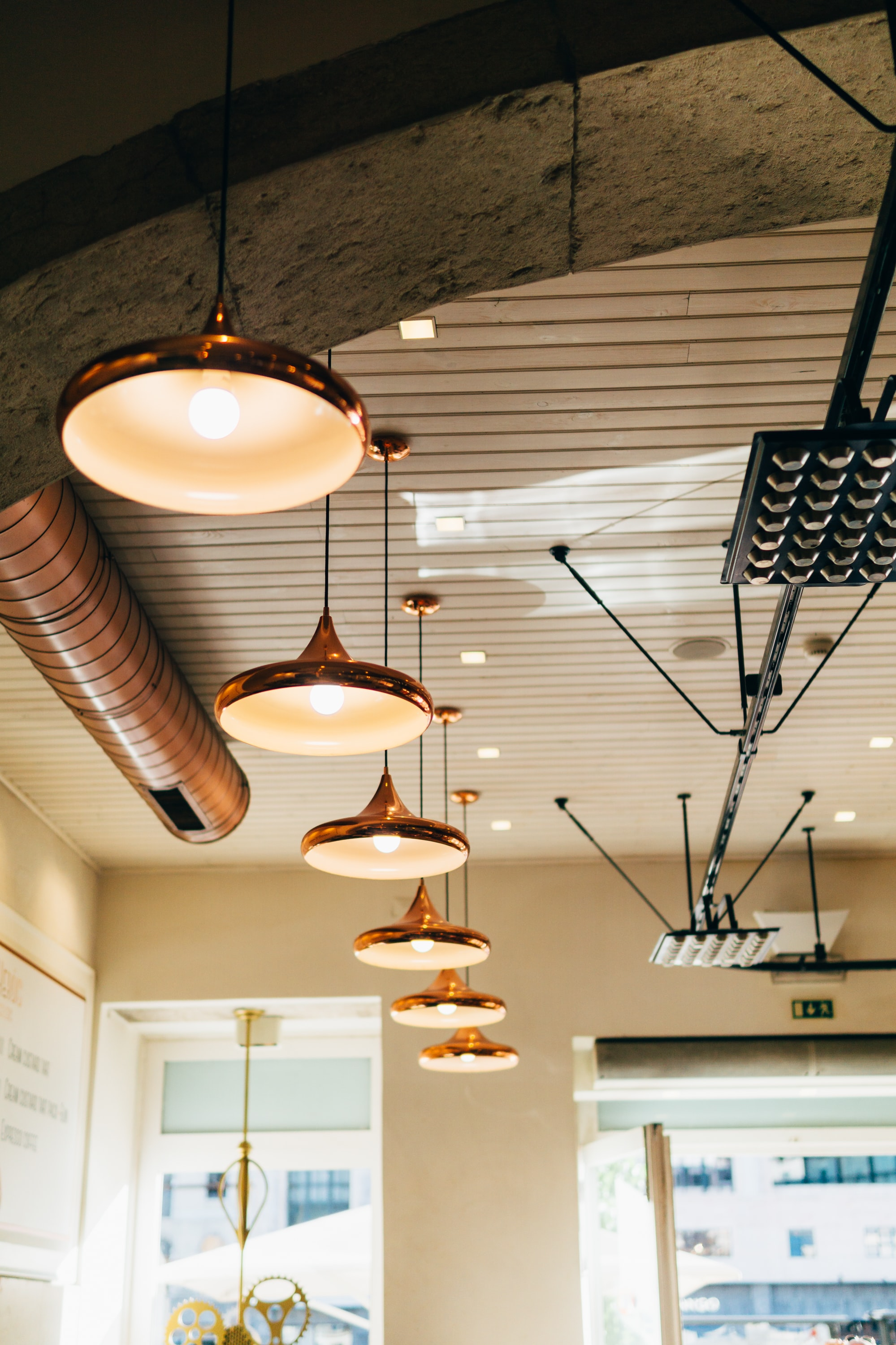 several turned on pendant lamps