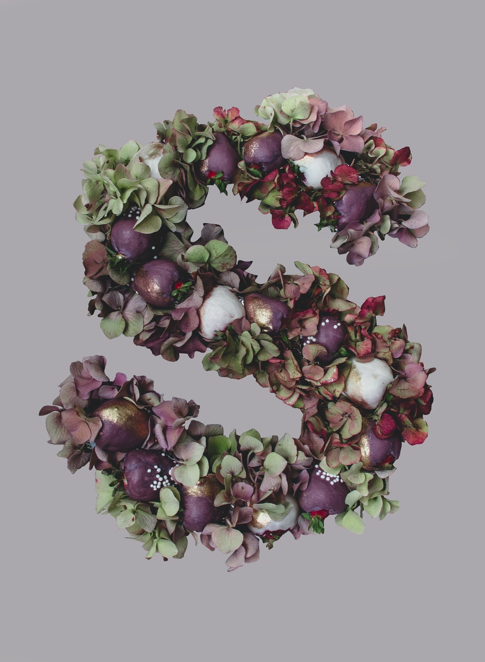 purple and white floral S letter decor