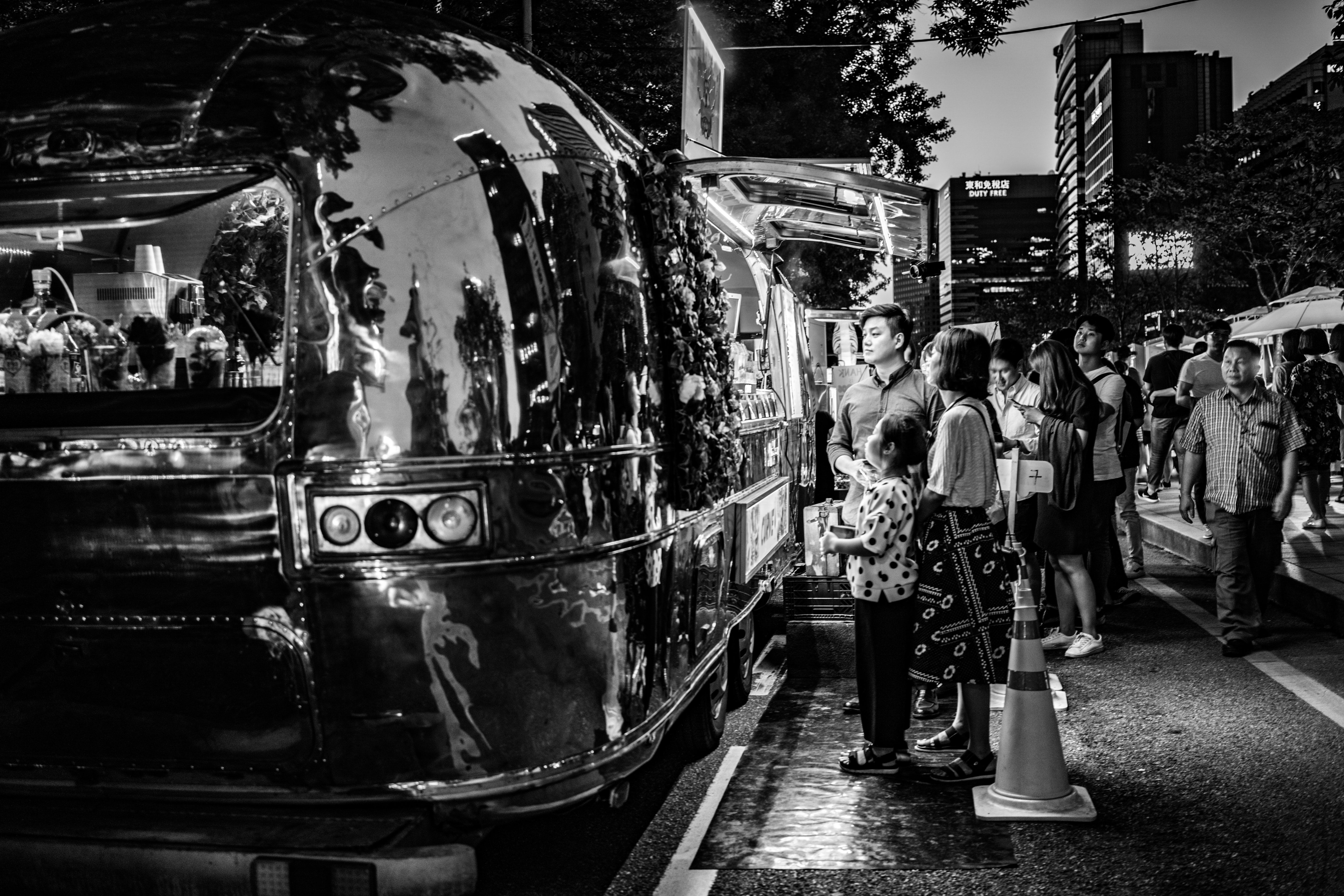 grayscale photography of people near food truck