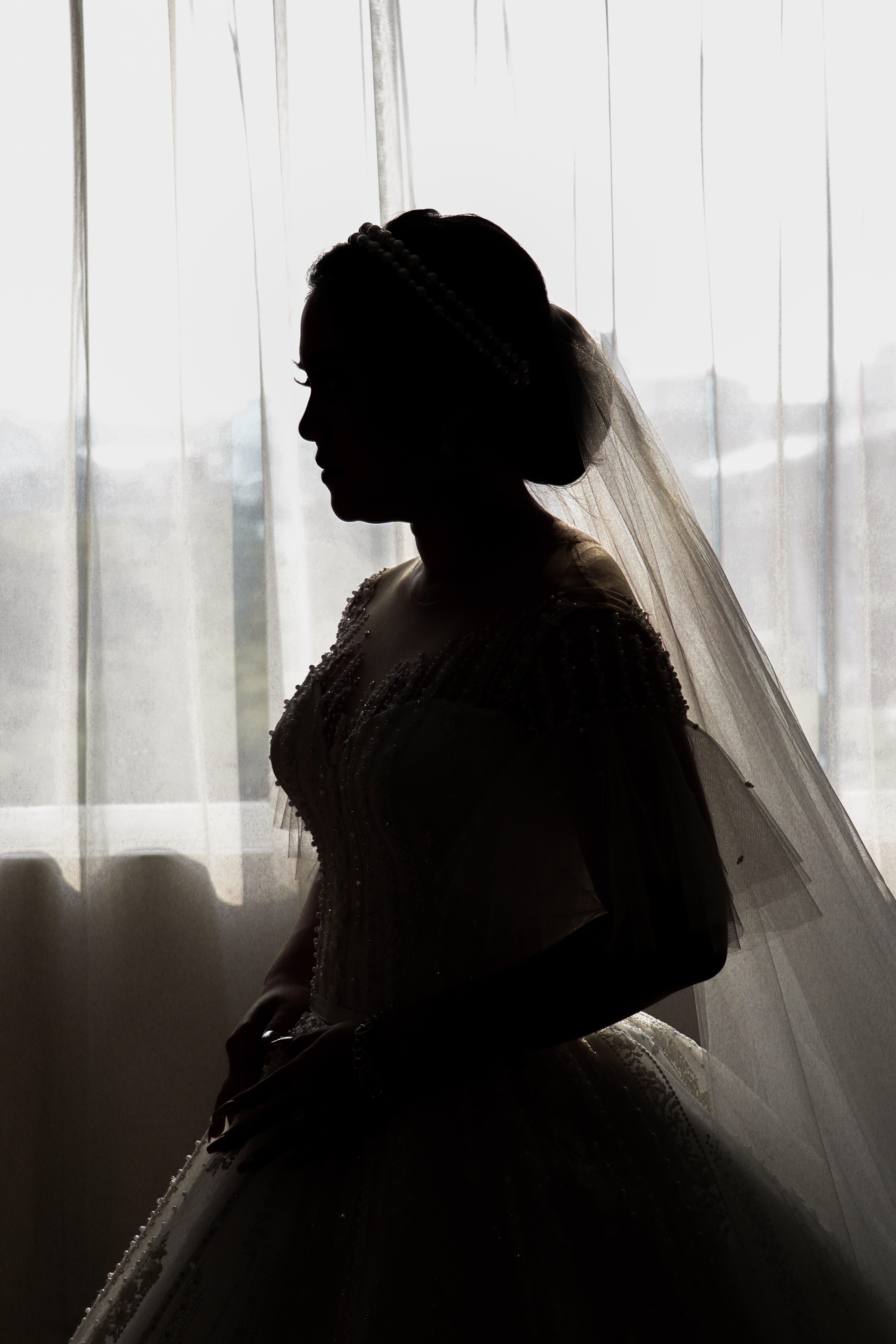 woman in white bridal gown and veil