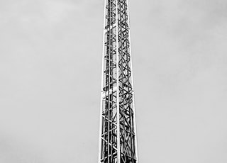 grayscale photo of park ride