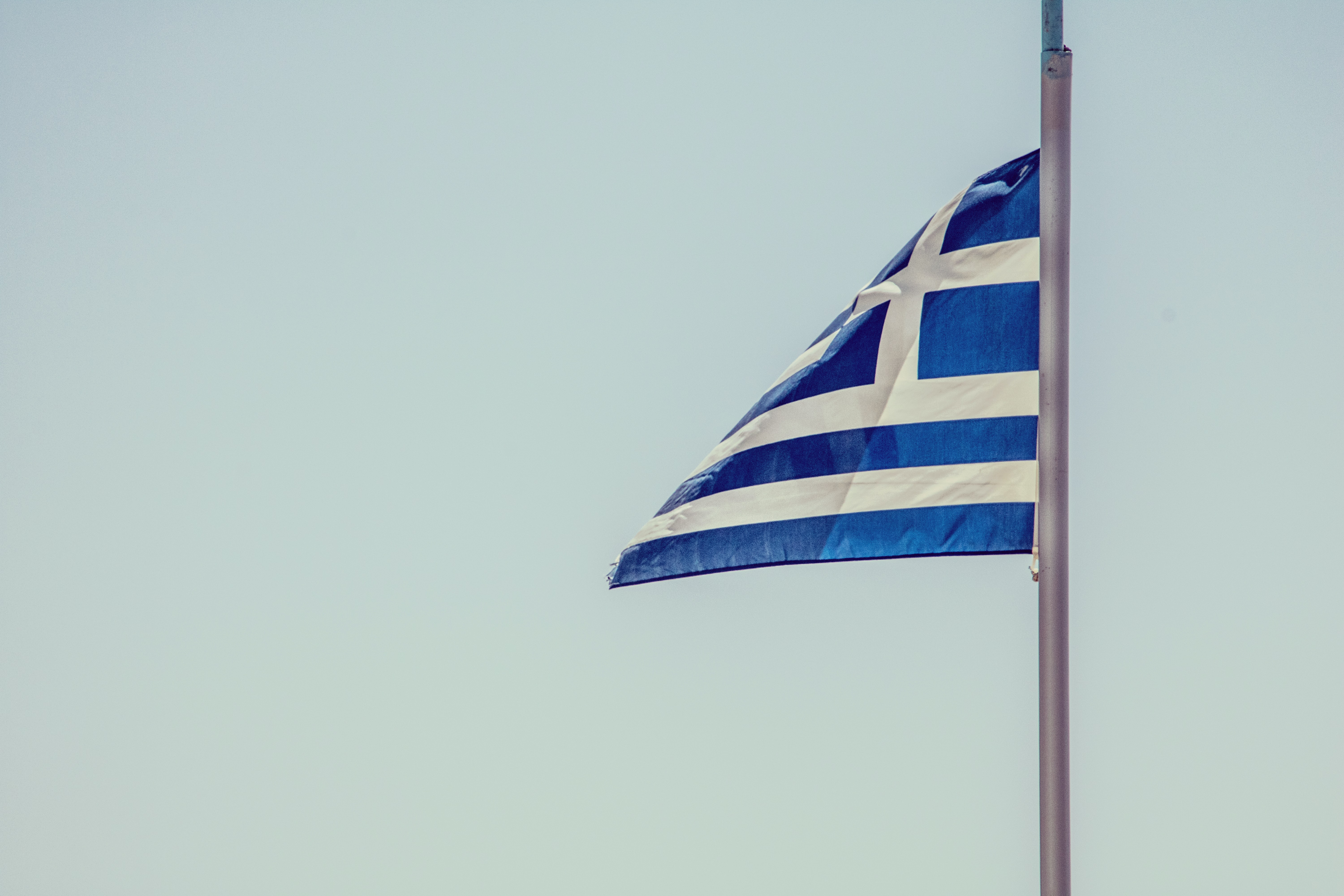 blue and white striped flag on pole