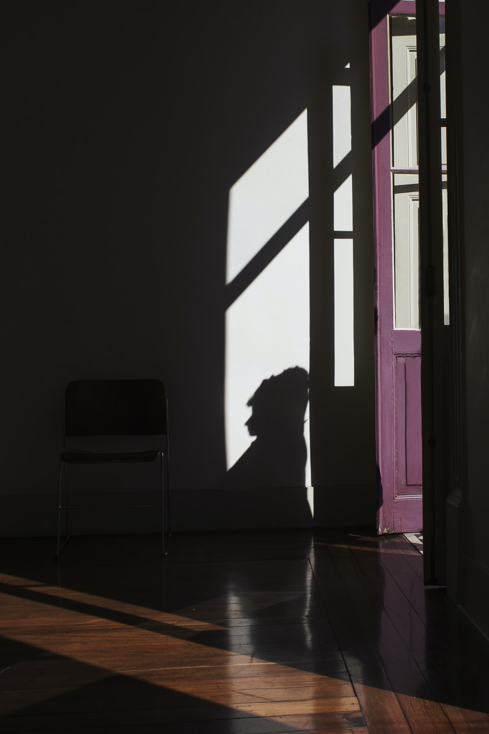silhouette of person on wall