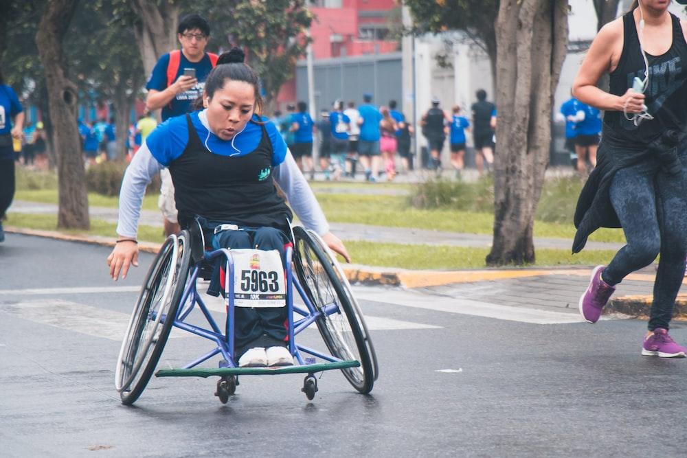 woman sitting on wheelchair during fun run