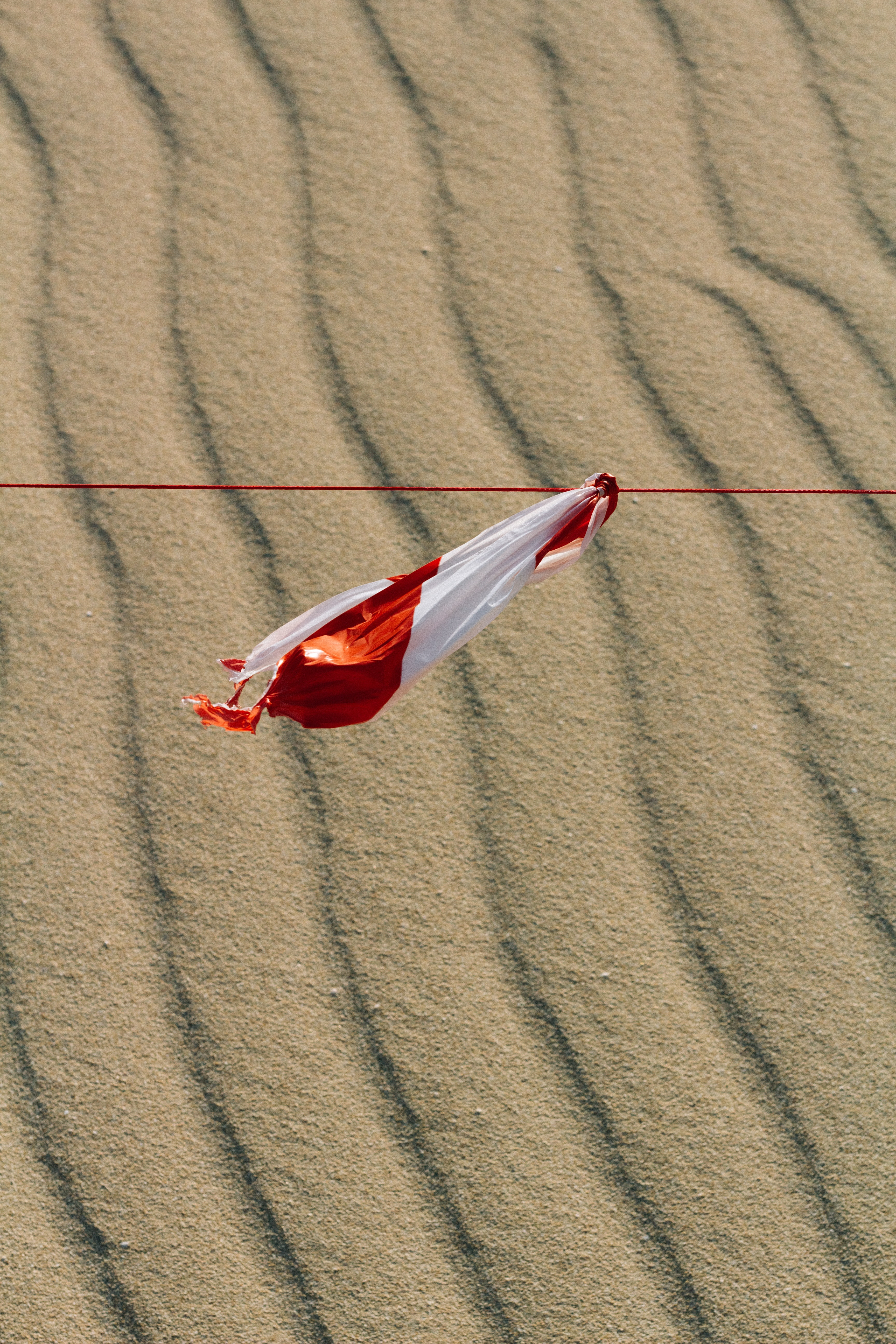 waving red and white textile