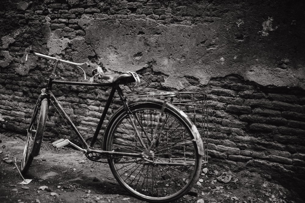 bicycle parked near wall