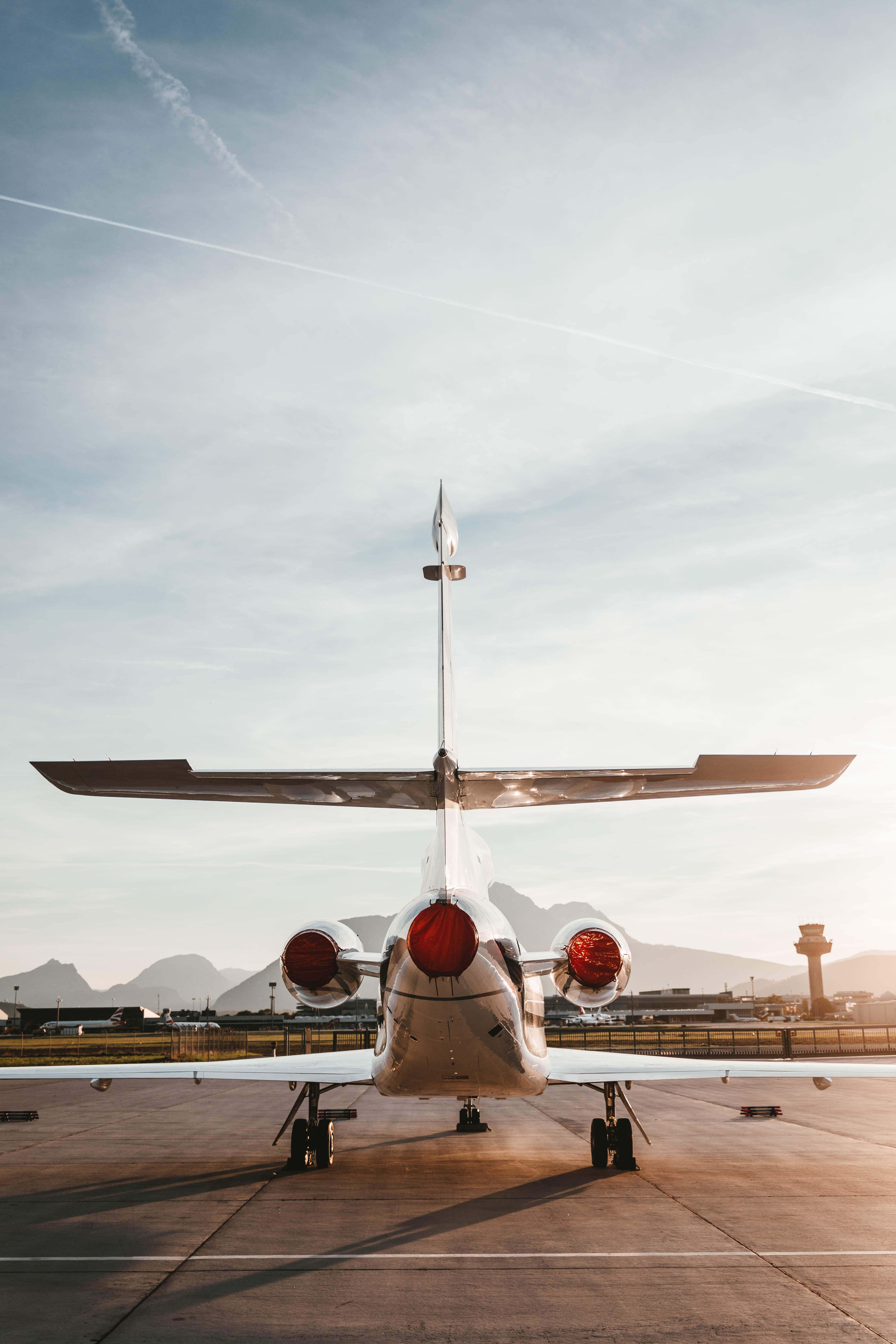 white biplane on field