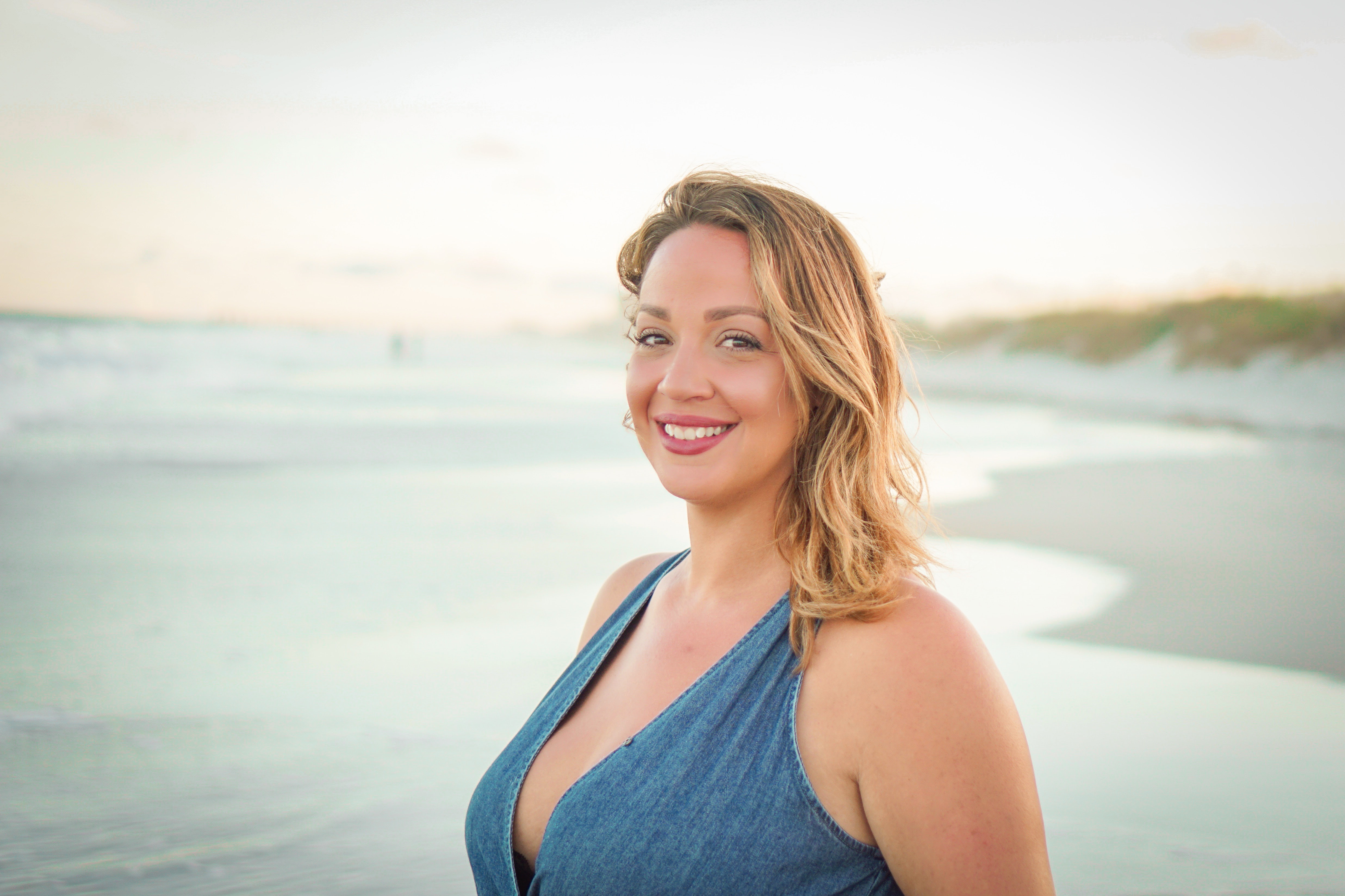 woman smiling with sea shore background