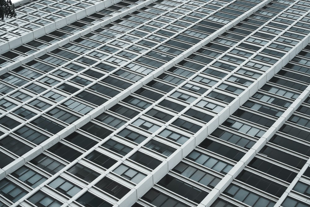 low-angle photography of white and black high rise building
