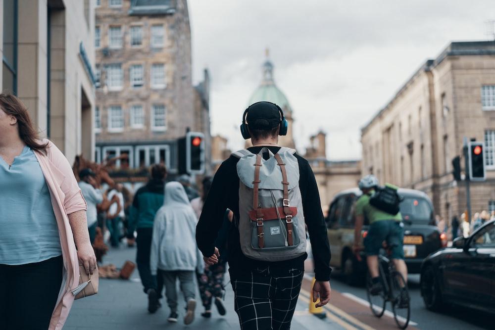 peoples walking on street