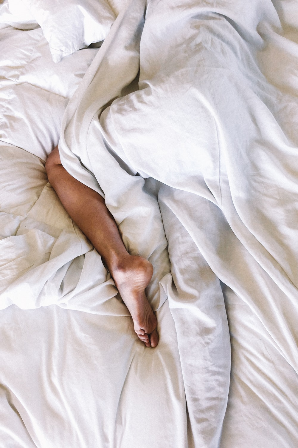 woman covered with white blanket