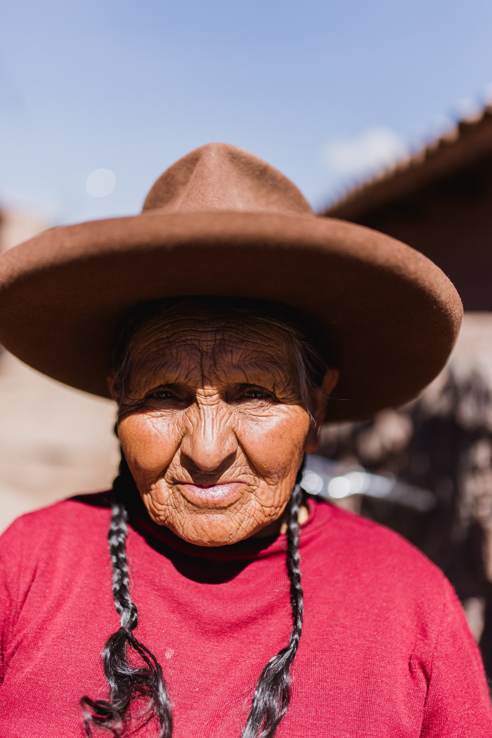 selective focus photo of woman wearing brown hat during daytime