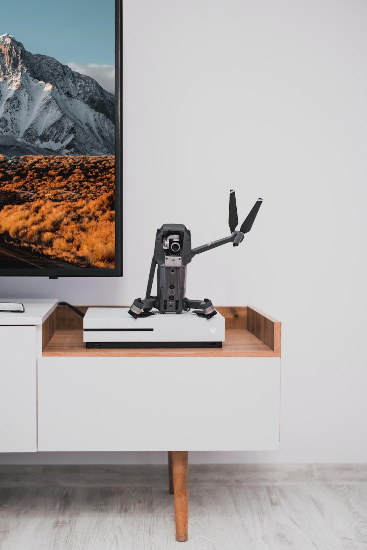 gray quadcopter on white Microsoft Xbox One