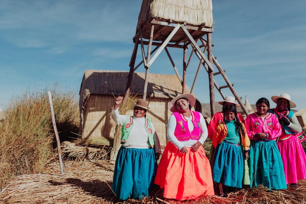 several women standing near tower