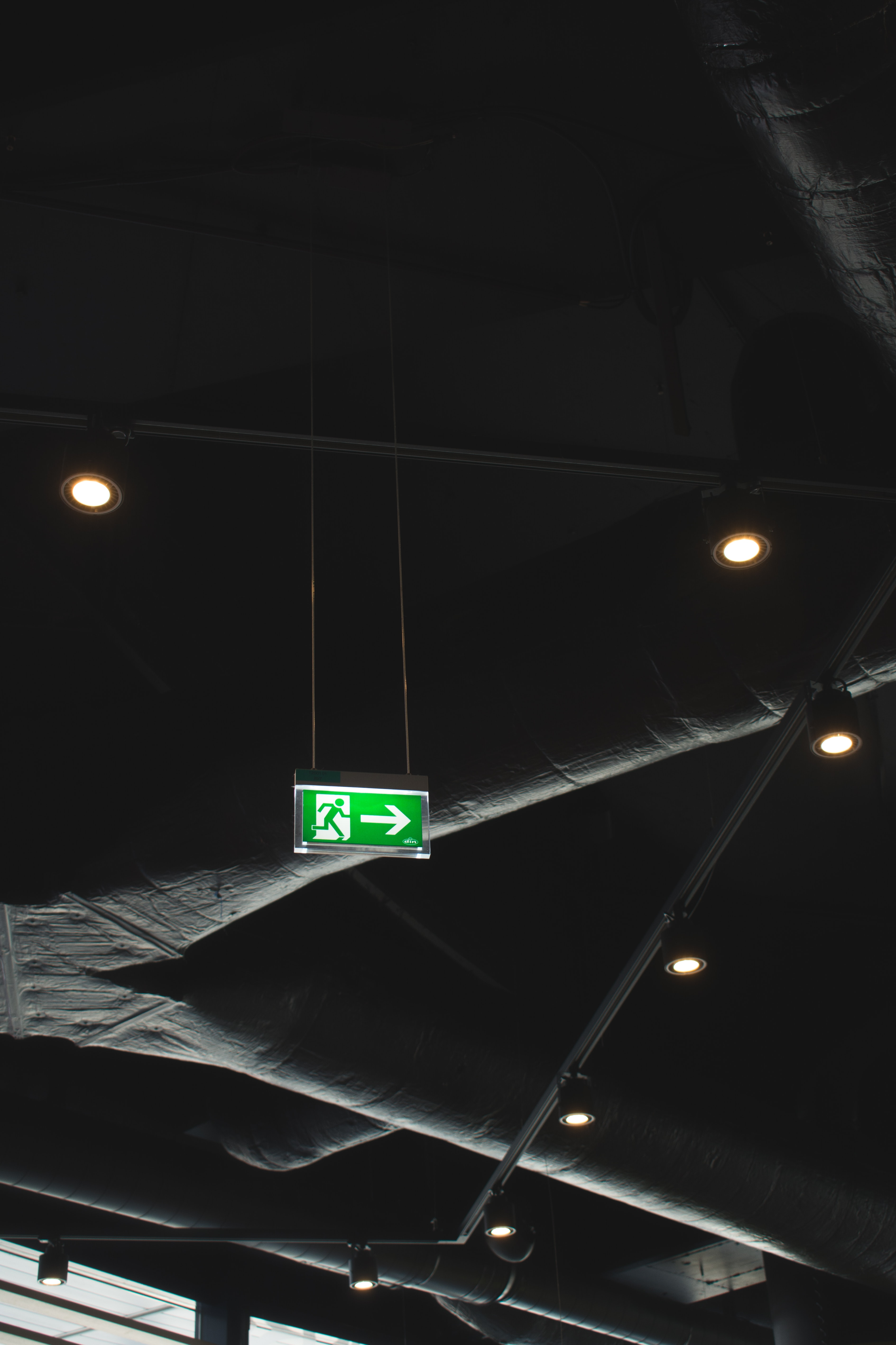 green signage on ceiling